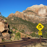 Curve caution sign on road winding through desert of Zion Nation poster
