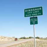city limit sign for city of dinosaur, colorado, usa. poster