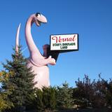 pink dinosaur holding sign for city of vernal, utah. poster