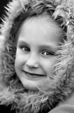 young girl in fluffy coat poster