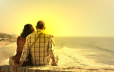 couple seated watch the sunset