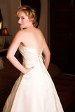 young blonde bride wearing wedding gown poster