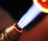 the blue flame heats the glass bead poster