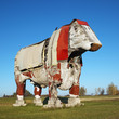 large wooden cow sculpture.