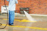 a crew member cleans the painted street markings poster