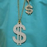 green medical scrubs with dollar sign necklaces. poster