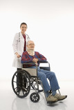 doctor pushing elderly man with neck brace in wheelchair. poster