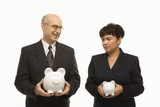 businesspeople holding piggybanks.