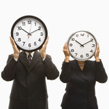 businesspeople holding clocks. poster