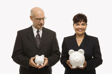 businesspeople holding piggybanks.