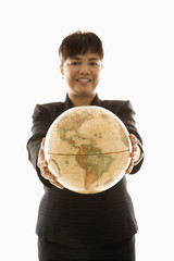 businesswoman holding globe.