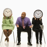 businesswomen covering faces with clocks and businessman shruggi poster