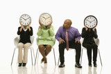 businesswomen covering faces with clocks with businessman lookin poster