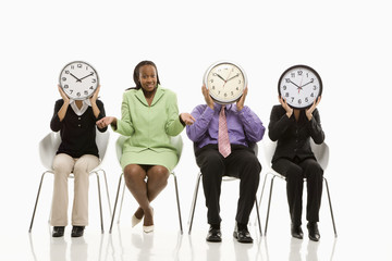 business people covering faces with clocks and businesswoman shr