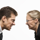 man and woman staring at each other with hostile expressions. poster