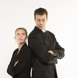 businesswoman and man standing back to back. poster