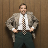 man in retro suit pulling up pants. poster