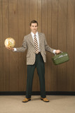 man in retro suit holding luggage and a globe. poster