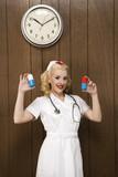 female nurse in retro uniform holding giant pills. poster