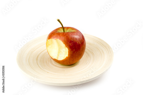 nibbled stripped apples on white background