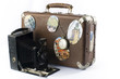 old suitcase, photo camera and clock