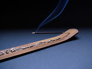 incense in holder zoom