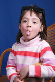 girl sticks out tongue poster