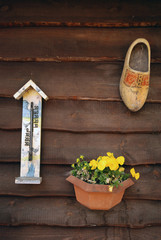 wall of farm with wooden shoe