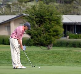 golf - putt rolls toward cup