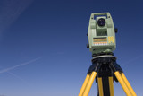land surveying under blue sky poster