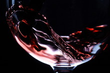 """Постер, картина, фотообои """"closeup of red wine pouring"""""""