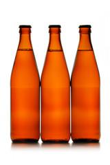 three beer bottles in a row