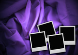 four photo frames against textile background poster