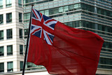 uk naval flag in front of office poster