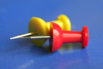 yellow and red push pins