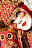 a red and gold costume at the venice carnival poster