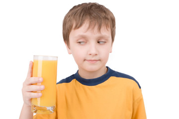 young boy with orange juice