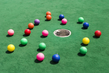 scattered golf balls