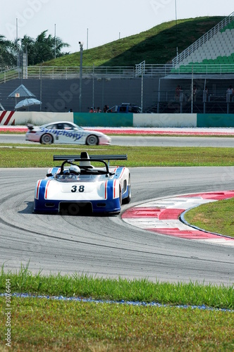 Foto op Canvas Snelle auto s racing car at the track