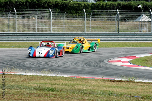 Foto op Canvas Snelle auto s racing cars at a track