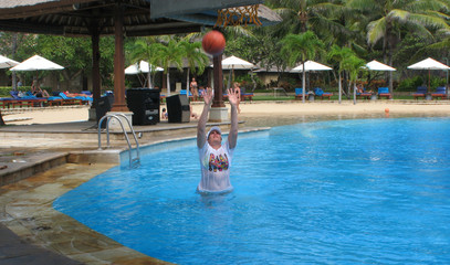 women play basketball in the pool