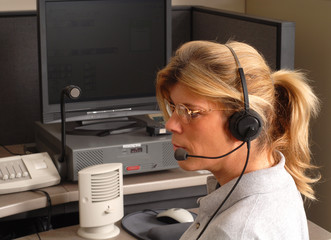 police dispatcher sitting at a dispatch console