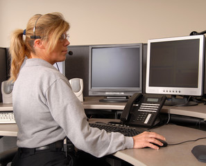 police dispatcher working at console