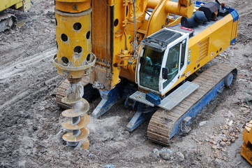 caterpillar tractor drills earth