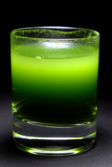 wheatgrass juice in shot glass