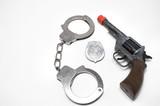 badge, handcuffs and gun poster