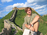 a trekker man having some rest on the great wall of china, china