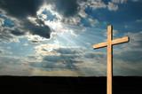 light shining on cross poster