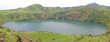 blue lake with green grass around, cameroon, africa, panorama