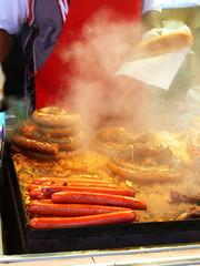 vendor cooking sausages